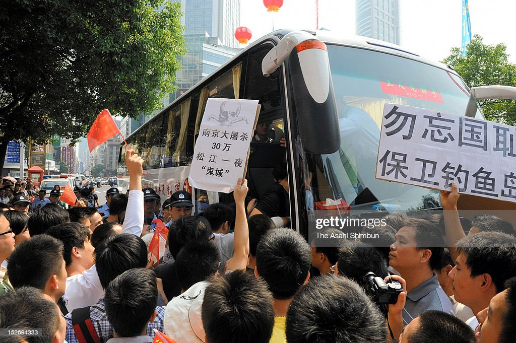 Protesters get on a bus chartered by the local authority to send them to the Japanese Consulate General during an anti Japan rally on September 18, 2012 in Shanghai, China. There were protests in many major cities in China, including Shanghai, Shenzhen, Shenyang, Hangzhou, Harbin, Qingdao and Hong Kong as they oppose to the Japanese government's purchase of the disputed Senkaku/Diaoyu islands.