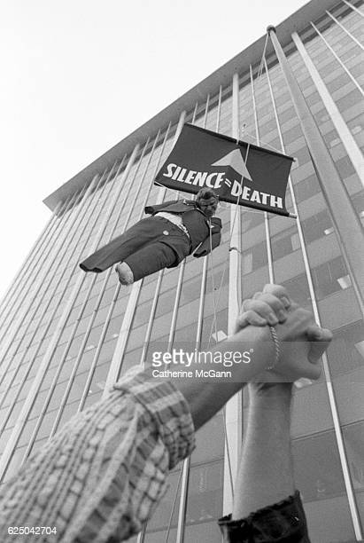 Protesters hang an effigy of Ronald Regan under a sign stating 'Silence Equals Death' at a protest organized by AIDS activist group ACT UP at the...
