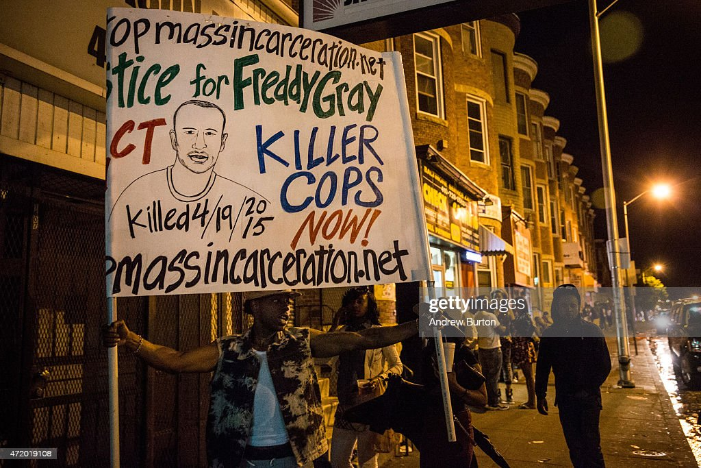 Protesters hang out in Sandtown neighborhood where Freddie Gray was arrested on May 2, 2015 in Baltimore, Maryland. Gray later died in custody; the Maryland state attorney announced yesterday that charges would be brought against the six police officers who arrested Gray.