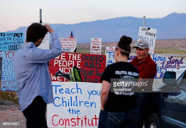 Protesters hang signs on a fence along US highway 170 protesting the closure of thousands of acres of Bureau of Land Management land that has been...