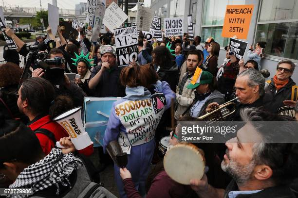 Protesters heckle the passing motorcade of President Donald Trump near the USS Intrepid where President he is scheduled to host Australian Prime...