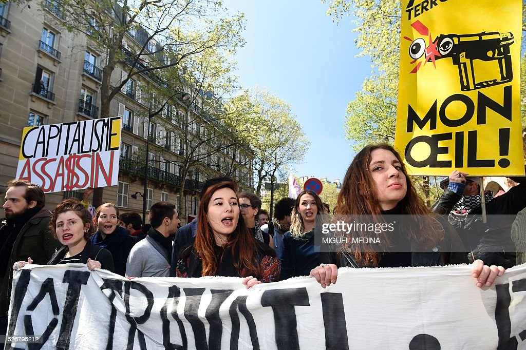 Protesters hold a banner as they attend a traditional May Day demonstration on May 1, 2016, in Paris.