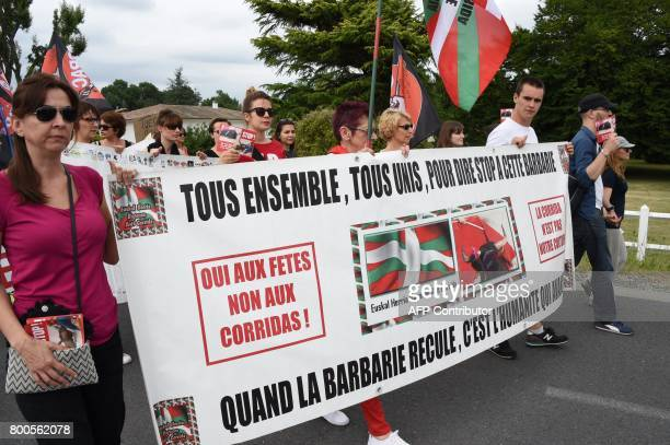 Protesters hold a banner during a demonstration against bullfighting on June 24 2017 in the French city of La Brede western France Around 60...