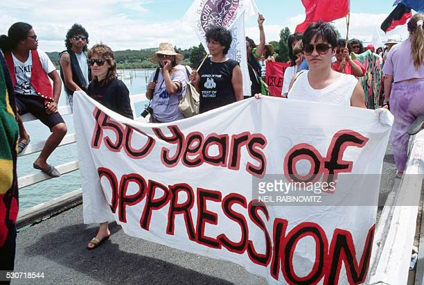 Protesters hold a banner reading '150 years of OPPRESSION' during Queen Elizabeth's visit to New Zealand They're refering to the Treaty of Waitangi...