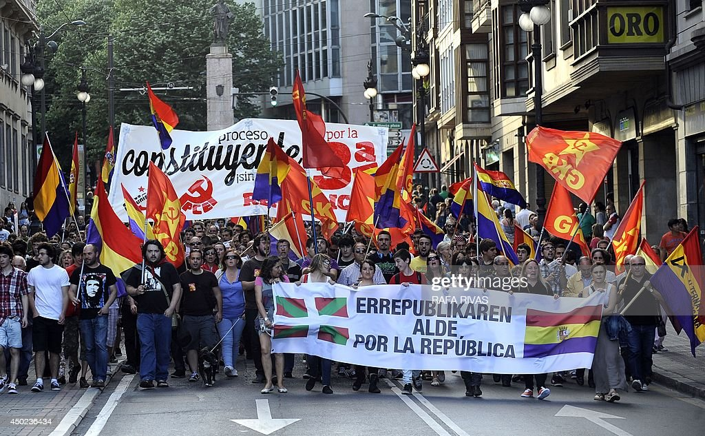 Protesters hold a banner reading 'For the Republic' during a demonstration to demand a referendum on the monarchy following the abdication of King Juan Carlos, in the northern Spanish Basque city of Bilbao on June 7, 2014. Dozens of left-wing political parties and citizens organisations came together to demand 'A referendum now!' on the future of the monarchy. Spanish King Juan Carlos' abdication on June 2 revived anti-royalist fervour in the young democracy, sending thousands into the streets clamouring for a referendum on the monarchy itself.