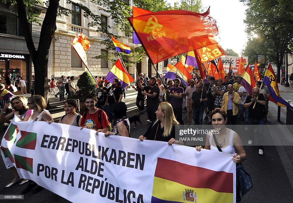 Protesters hold a banner reading 'For the Republic' during a demonstration to demand a referendum on the monarchy following the abdication of King Juan Carlos, in the northern Spanish Basque city of Bilbao on June 7, 2014. Dozens of left-wing political parties and citizens organisations came together to demand 'A referendum now!' on the future of the monarchy. Spanish King Juan Carlos' abdication on June 2 revived anti-royalist fervour in the young democracy, sending thousands into the streets clamouring for a referendum on the monarchy itself. AFP PHOTO / RAFA RIVAS