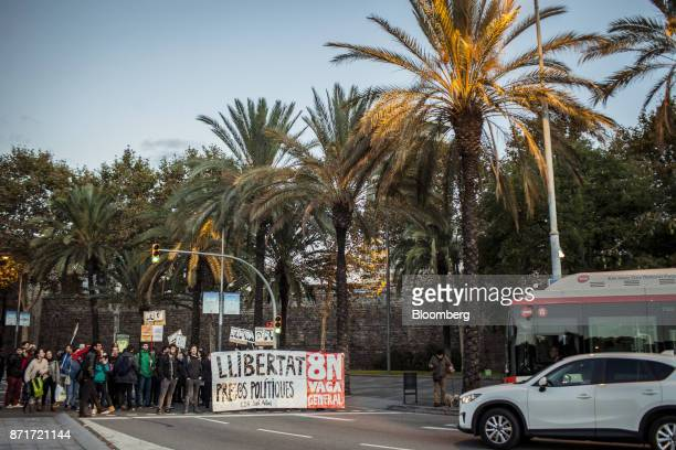 Protesters hold a banner reading 'Freedom for political prisoners' across Paralelo Avenue as they blockade city roads during a regional strike called...