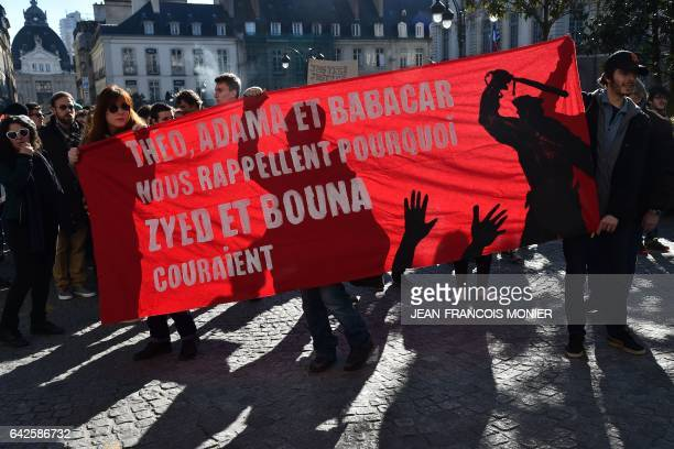Protesters hold a banner reading 'Theo Adama and Babacar remind us why Zyed and Bouna were running' during a demonstration against police brutality...