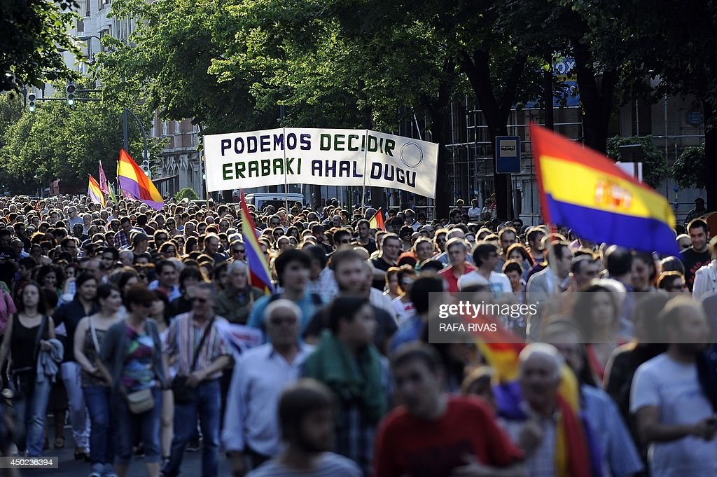 Protesters hold a banner reading 'We can decide' during a demonstration to demand a referendum on the monarchy following the abdication of King Juan Carlos, in the northern Spanish Basque city of Bilbao on June 7, 2014. Dozens of left-wing political parties and citizens organisations came together to demand 'A referendum now!' on the future of the monarchy. Spanish King Juan Carlos' abdication on June 2 revived anti-royalist fervour in the young democracy, sending thousands into the streets clamouring for a referendum on the monarchy itself.