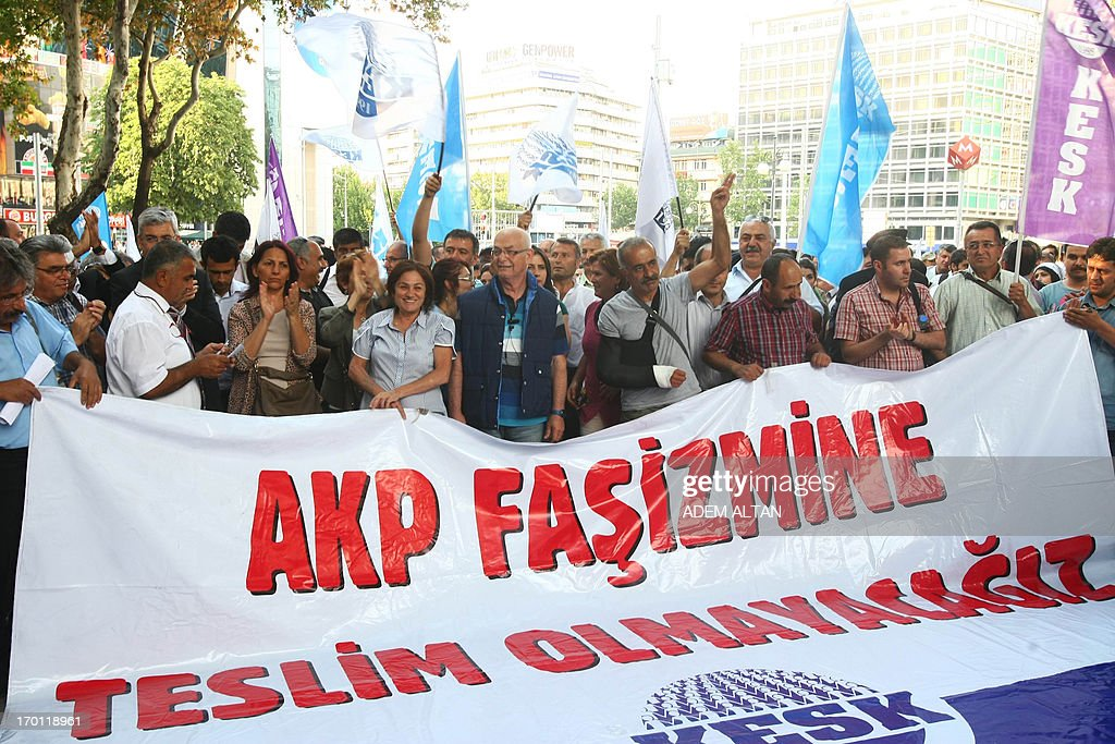 Protesters hold a banner reading 'We will not bow to AKP fascism' as they demonstrate in the center of Ankara, on June 7, 2013. Turkish Prime Minister Recep Tayyip Erdogan said today his Islamic-rooted government was open to 'democratic demands' and hit back at EU criticism of his handling of a week of deadly unrest. Amid international condemnation over rights abuses in the unrest, European Union Enlargement Commissioner Stefan Fule told Erdogan that excessive police force 'has no place' in a democracy, urging a 'swift and transparent' probe into the abuses in Turkey, a longtime EU hopeful.
