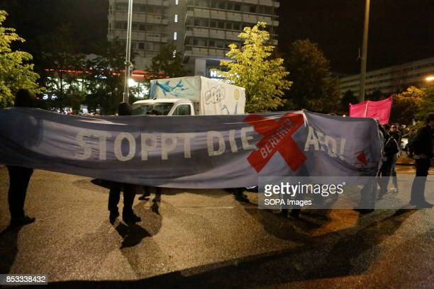 Protesters hold a banner that reads 'Stop the Berlin AfD' Hundreds of protesters gathered outside a club near the central Alexanderplatz in Berlin...