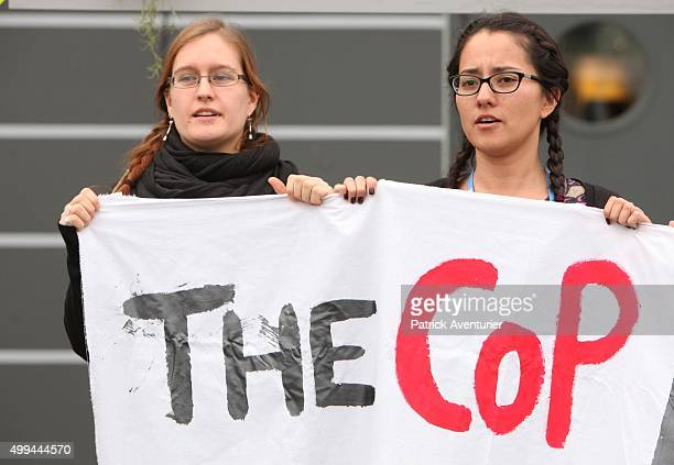 Protesters hold a banner with the words 'THE COP' at Le Bourget on December 1 2015 in Paris France The COP21 summit will see negotiators from 195...