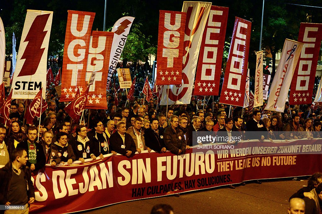 Protesters hold a giant banner reading in Spanish, English and German 'We are left with no future. There are culprits. There are solutions' and banners of Spain's unions, including the Workers' Trade Unionist Federation (USO), the Comisiones Obreras trade union (CCOO) and the General Union of Workers (UGT), as they attend a demonstration during a general strike on November 14, 2012 in Madrid. The second general strike this year hit Spain with protesters marching in several cities against sweeping austerity measures and high unemployment, scenes echoed elsewhere in Europe. Spain, the eurozone's fourth-biggest economy, is suffering 25 percent unemployment, with the rate even higher amongst young people.