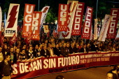 Protesters hold a giant banner reading in Spanish English and German 'We are left with no future There are culprits There are solutions' and banners...