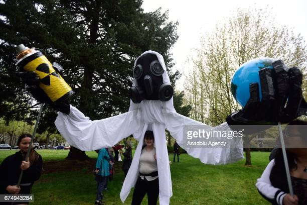 Protesters hold a giant puppet during the People's Climate March in Portland Ore United States on April 29 2017 Thousands turned out in solidarity...