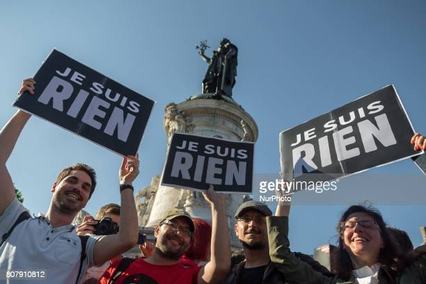 Protesters hold a placard reading quotI am Nothingquot as people gather to listen to La France Insoumise leftist party's leader delivering a speech...
