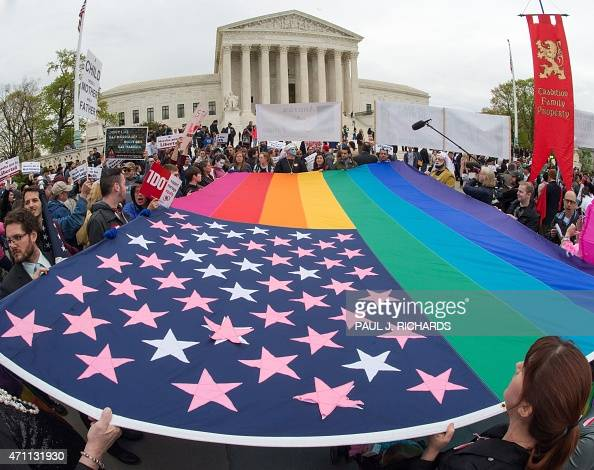 Protesters hold a progay rights flag outside the US Supreme Court on April 25 countering the demonstrators who attended the March For Marriage in...