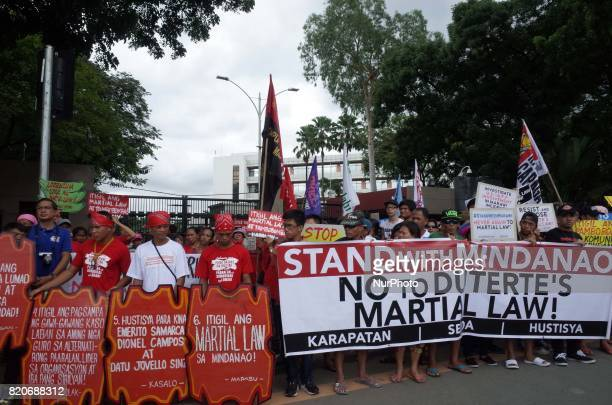Protesters hold a rally coinciding the joint session on Martial Law extension outside the House of Representatives in Quezon City northeast of Manila...