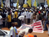 Protesters hold a US flag reading 'Death to America' during a demonstration in the city of Kaduna in Nigeria's mainly Muslimpopulated north against a...