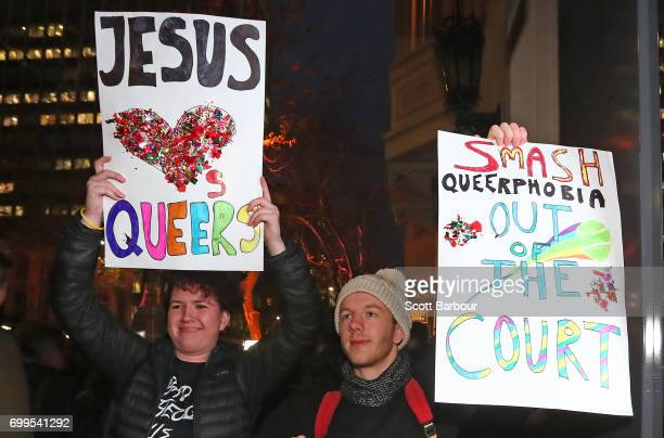 Protesters hold aloft placards outside of the Athenaeum club where former Australian tennis player and Christian pastor Margaret Court is the keynote...