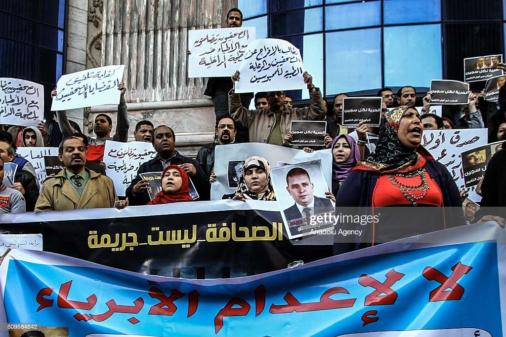 Protesters hold banners and posters as they hold a demonstration demanding the release of imprisoned journalists, in front the Press Union building in Cairo, Egypt on February 11, 2016.
