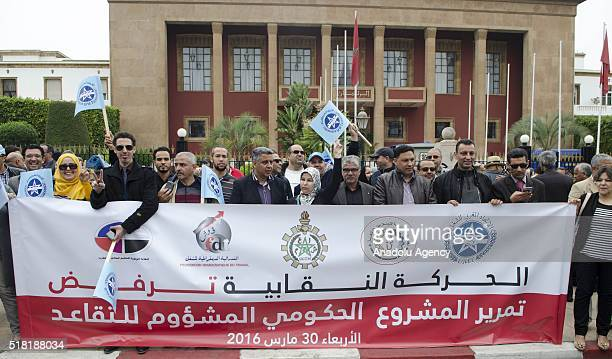 Protesters hold banners and shout slogans during a demonstration protesting government's new retirement law in front of the parliament building in...