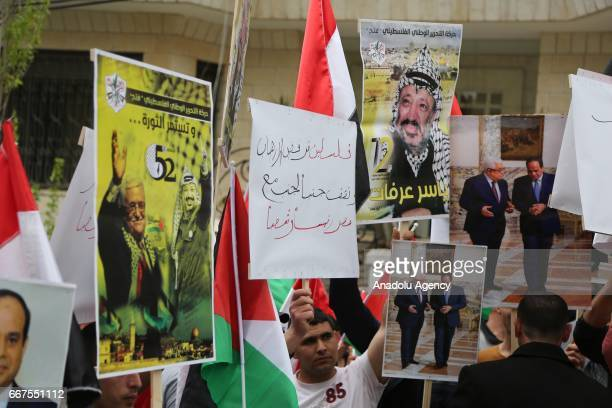 Protesters hold banners as they stage a protest against the terror attacks to churches at Alexandria and Tanta of Egypt in front of the Egyptian...