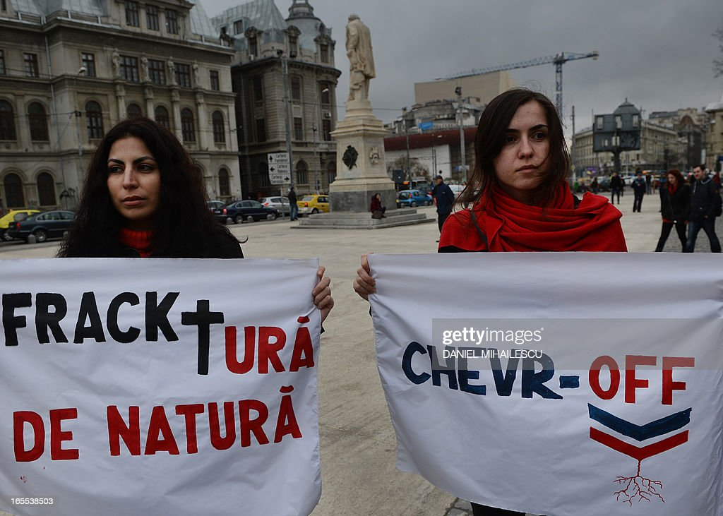Protesters hold banners during a demonstration against hydraulic fracturing (fracking) in Bucharest April 4, 2013. Around 300 protesters gathered in Bucharest's University Square in protest against the drilling technique, which uses high pressure injections of water, sand and chemicals to crack open rock and release oil and gas trapped inside. Hundreds of Romanians rallied in several cities to protest against shale gas drilling, voicing concerns over environmental pollution and health hazards.The protesters called on the centre-left government to revoke permits granted to several oil groups, including US giant Chevron, enabling them to start exploration drilling. 'Chevron, go home,' and 'Down with traitors', they chanted, in reference to Prime Minister Victor Ponta who earlier this year said he was favorable to shale gas drilling after repeatedly declaring he was against, while he was in opposition.Nearly 1,000 people rallied in Barlad, an eastern Romanian city lying close to a 600,000 hectare concession granted to Chevron.Several hundred persons also staged a protest in Buzias, a resort famous for its mineral water lying in a western Romanian region where a Luxembourg-based company plans to start drilling. A U.S. Energy Information Administration study said the joint reserves for Romania, Bulgaria and Hungary were around 538 billion cubic metres, among the biggest in eastern Europe.