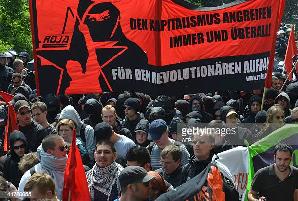 Protesters hold banners during a march of the anticapitalist movement known as 'Blockupy Frankfurt' that marched through the centre of the German...