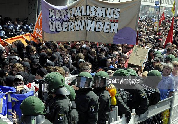 Protesters hold banners during a march of the anticapitalist movement known as 'Blockupy Frankfurt' through the centre of the German financial...