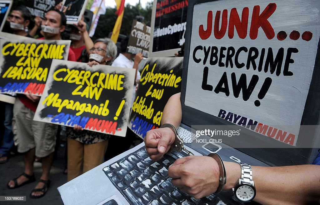 Protesters hold banners during a rally against the cybercrime law in front of the Supreme Court building in Manila on October 9, 2012. The Philippine Supreme Court on October 9 suspended a controversial cybercrime law, the government said, amid huge online protests over fears it would impose enormous curbs on Internet freedoms.