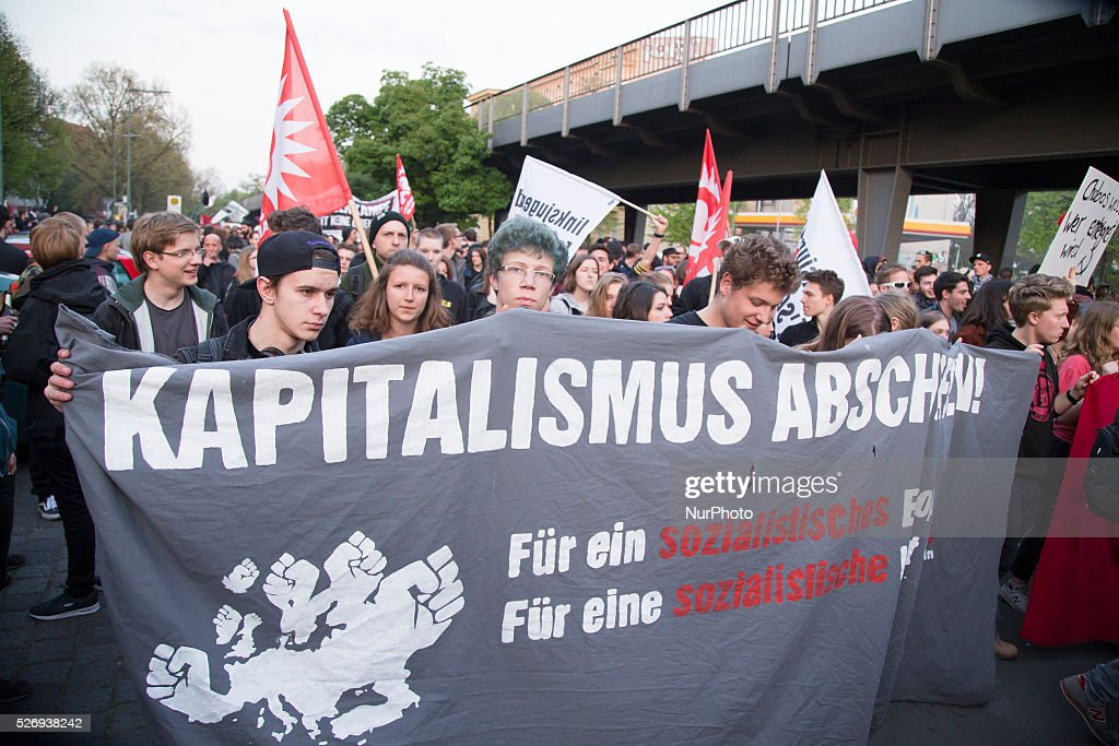 Protesters hold banners during the annual May Day demonstration in the Kreuzberg district on May 1, 2016 in Berlin, Germany. May Day, or International Workers' Day, was established as a public holiday in Germany in 1933. Since 1987 May Day has also become known in Berlin for violent clashes between police and mostly left-wing demonstrators.
