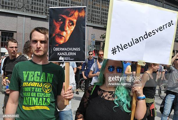 Protesters hold banners in Berlin during a demonstration to support the internet portals Netzpolitikorg in Berlin Germany on August 1 2015 after two...