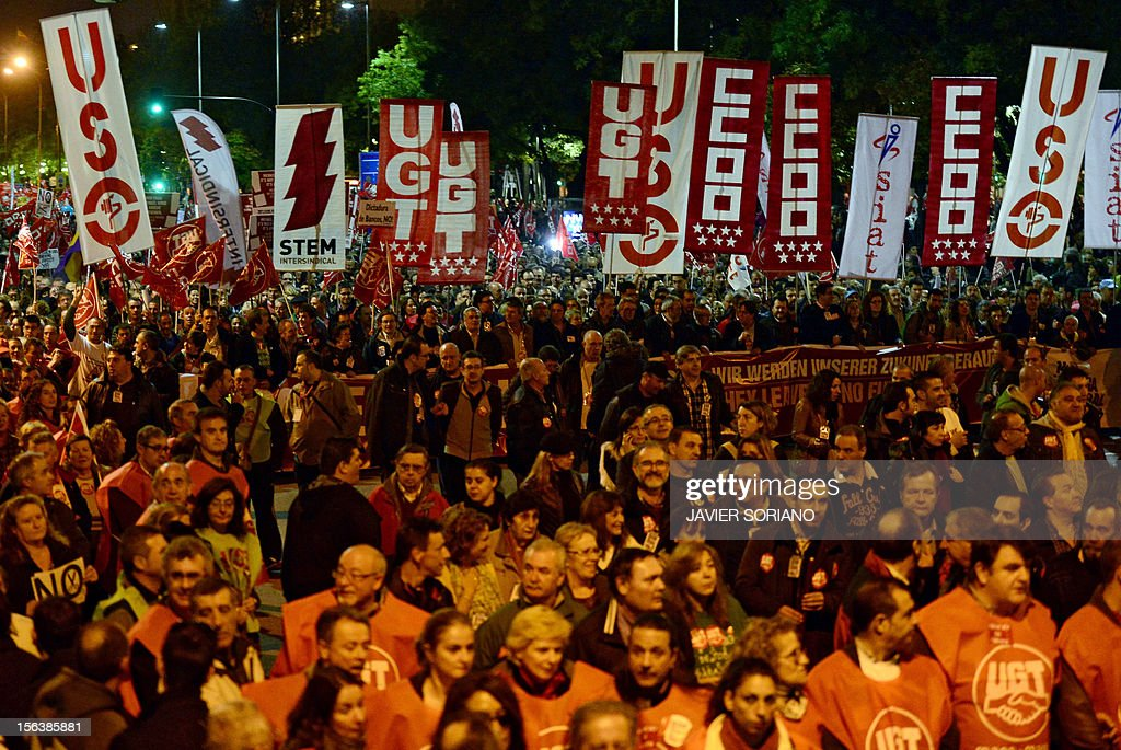 Protesters hold banners of Spain's unions, including the Workers' Trade Unionist Federation (USO), the Comisiones Obreras trade union (CCOO) and the General Union of Workers (UGT), as they attend a demonstration during a general strike on November 14, 2012 in Madrid. The second general strike this year hit Spain with protesters marching in several cities against sweeping austerity measures and high unemployment, scenes echoed elsewhere in Europe. Spain, the eurozone's fourth-biggest economy, is suffering 25 percent unemployment, with the rate even higher amongst young people. AFP PHOTO / JAVIER SORIANO