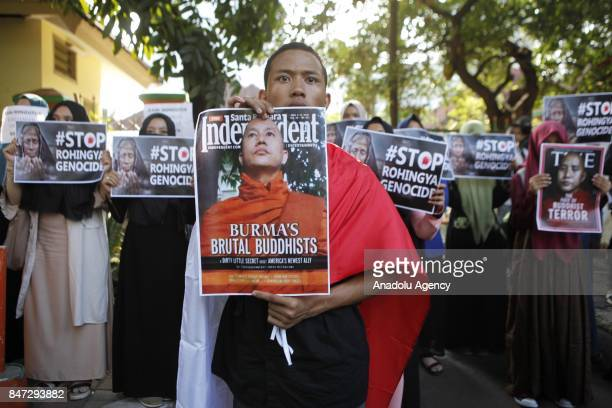 Protesters hold banners reading 'Burma's Brutal Buddhists The Face of Buddhist Terror with the image of Myanmar Buddhist Monk Wirathu #Stop Rohingya...