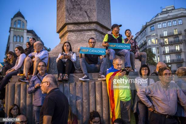 Protesters hold banners reading 'Help Catalonia' during a candlelit vigil to demand the release of imprisoned seperatist leaders Jordi Sanchez head...