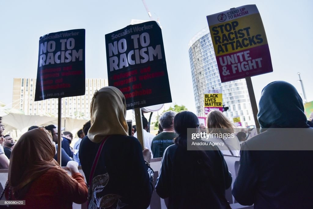 Protesters hold banners reading 'No To Racism - Refugees And Migrants Welcome - Stamp Out Islamophobia - Stop Racist Attacks - Unite And Fight' at a vigil for Resham Khan and Janeel Muhktar who were attacked with sulphuric acid in London, United Kingdom on July 05, 2017. Muhktar has stated that the attack was a hate crime and believed Its something to do with Islamophobia. The police are looking for John Tomlin in connection with the crime.