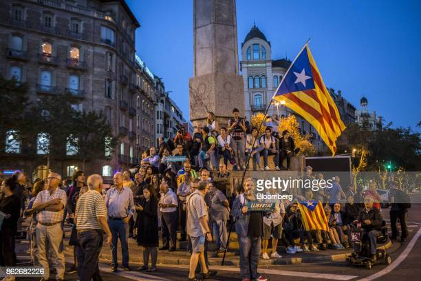 Protesters hold Catalan seperatist flags also known as Esteladas during a candlelit vigil to demand the release of imprisoned seperatist leaders...