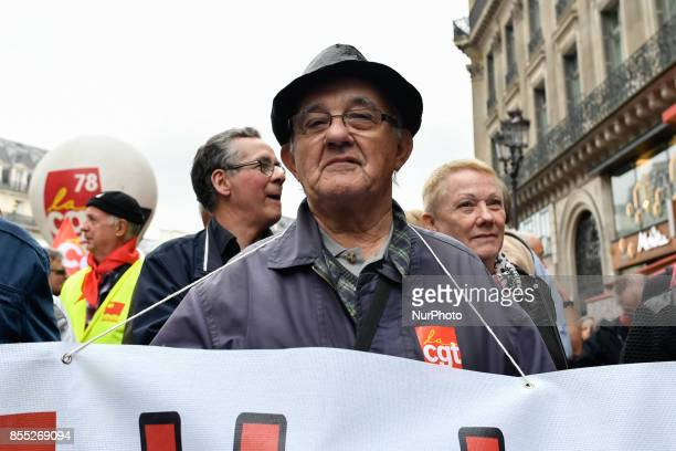 Protesters hold flags and march on the streets as pensioners demonstrate in Paris on September 28 2017 against the increase of the Social security...