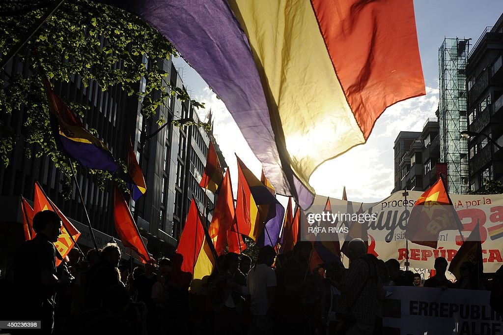 Protesters hold flags of the Spanish Second Republic during a demonstration to demand a referendum on the monarchy following the abdication of King Juan Carlos, in the northern Spanish Basque city of Bilbao on June 7, 2014. Dozens of left-wing political parties and citizens organisations came together to demand 'A referendum now!' on the future of the monarchy. Spanish King Juan Carlos' abdication on June 2 revived anti-royalist fervour in the young democracy, sending thousands into the streets clamouring for a referendum on the monarchy itself.