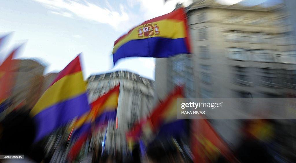 Protesters hold flags of the Spanish Second Republic during a demonstration to demand a referendum on the monarchy following the abdication of King Juan Carlos, in the northern Spanish Basque city of Bilbao on June 7, 2014. Dozens of left-wing political parties and citizens organisations came together to demand 'A referendum now!' on the future of the monarchy. Spanish King Juan Carlos' abdication on June 2 revived anti-royalist fervour in the young democracy, sending thousands into the streets clamouring for a referendum on the monarchy itself. AFP PHOTO / RAFA RIVAS