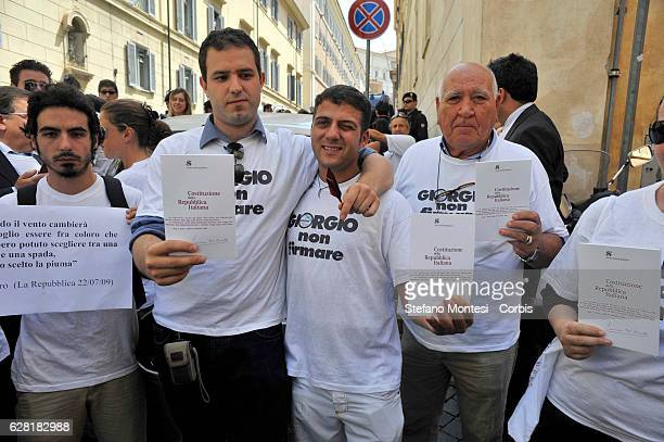 Protesters hold out the Italian Constitution during the demonstration of the Party Italy of Values outside the Quirinal Palace to ask the President...