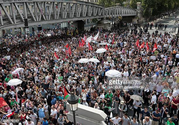 Protesters hold Palestinian and French New Anticapitalist Party flags and pictures of dead children as they gather near the BarbesRochechouart aerial...