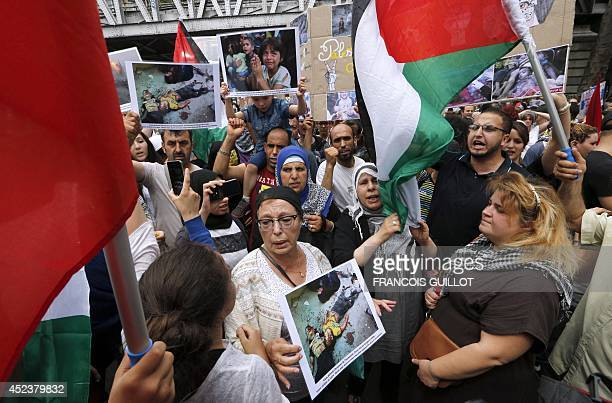Protesters hold pictures of dead children and Palestinian flags as they gather near the BarbesRochechouart aerial metro station prior to the...
