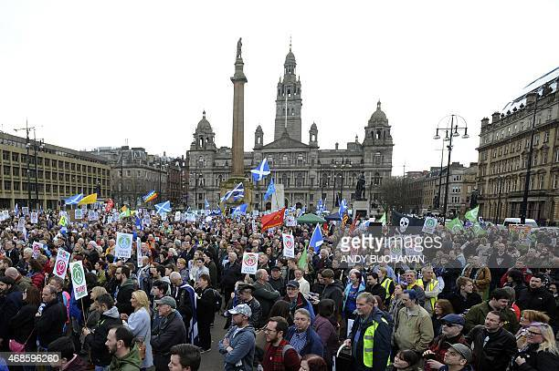 Protesters hold placards against nuclear weapons during a rally against the Trident nuclear programme in the centre of Glasgow Scotland on April 4...