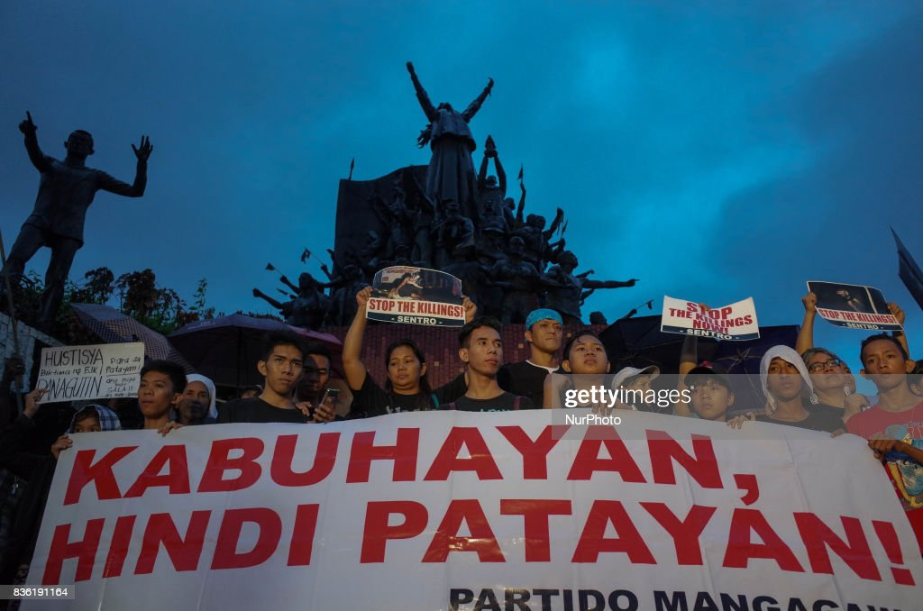 Protesters hold placards and slogans during a rally against extrajudicial killings in Quezon City, east of Manila, Philippines on Monday, 21 August 2017. The death of Kian Delos Santos, who was killed by policemen in an alleged shootout, has sparked protests and condemnation from the public against alleged extrajudicial killings on drug users and pushers.