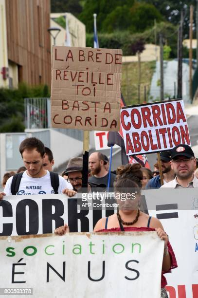 Protesters hold placards during a demonstration against bullfighting on June 24 2017 in the French city of La Brede western France Around 60...