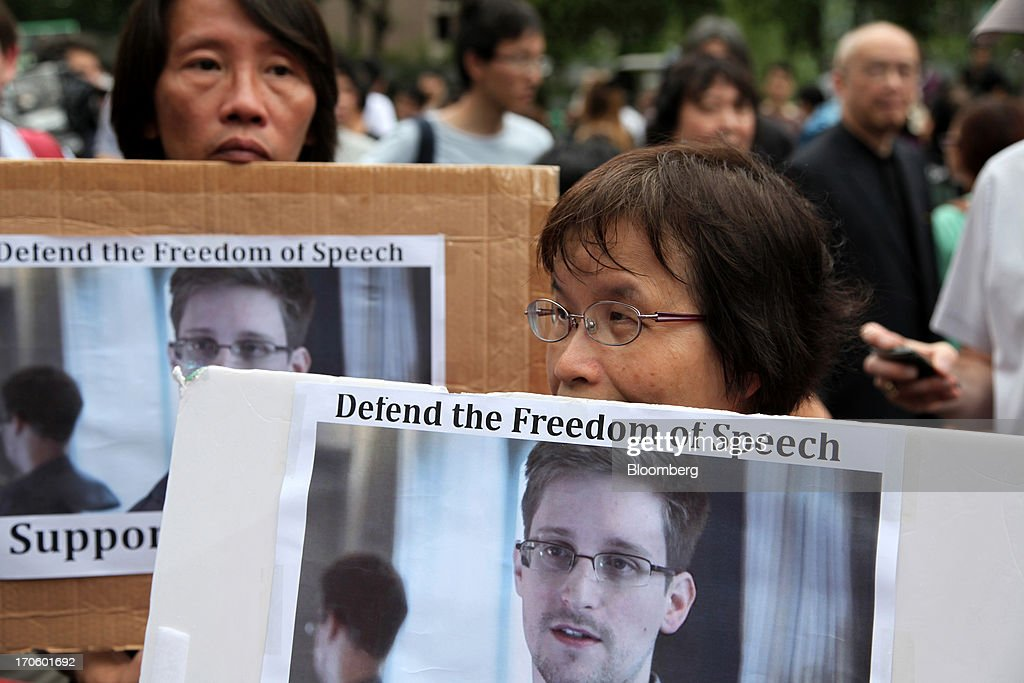 Protesters hold placards during a rally in support of Edward Snowden, the former National Security Agency contractor, in Hong Kong, China, on Saturday, June 15, 2013. Protesters marched to Hong Kongs government headquarters demanding their leaders protect Edward Snowden, who fled to the city after exposing a U.S. surveillance program. Photographer: Luke Casey/Bloomberg via Getty Images