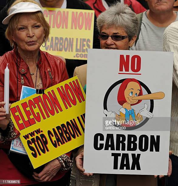 Protesters hold placards during a rally in Sydney on July 1 2011 against Australian Prime Minister Julia Gillard's plans to introduce a carbon tax A...