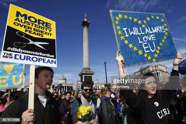 Protesters hold placards in front of Nelson's Column in Trafalgar Square during a Unite for Europe march to protest Brexit in central London UK on...